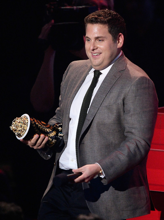 Description of . Actor Jonah Hill accepts the Best Comedic Performance award for 'The Wolf of Wall Street' onstage at the 2014 MTV Movie Awards at Nokia Theatre L.A. Live on April 13, 2014 in Los Angeles, California.  (Photo by Kevork Djansezian/Getty Images for MTV)