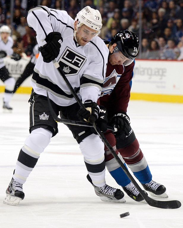 Description of . DENVER, CO. - JANUARY 22: Los Angeles Kings defenseman Alec Martinez (27) and Colorado Avalanche right wing David Jones (54) tangle during the first period. The Colorado Avalanche hosted the Los Angeles Kings at the Pepsi Center on January, 22, 2013.   (Photo By John Leyba / The Denver Post)