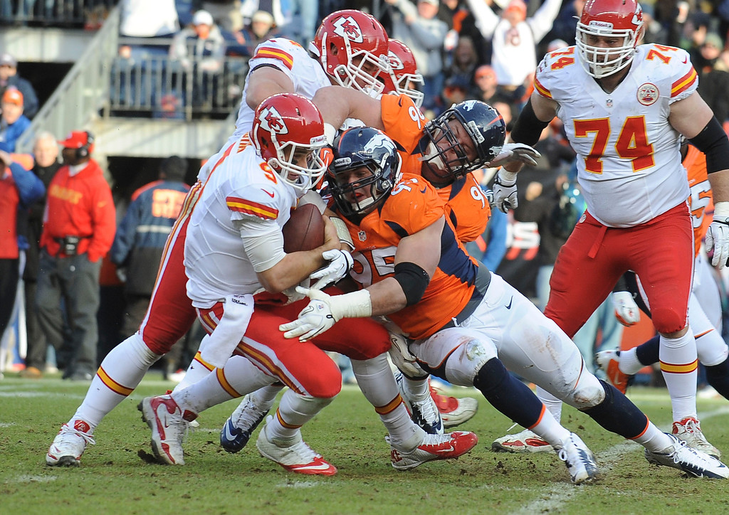Description of . Denver Broncos defensive lineman Derek Wolfe sacks Kansas City quarterback Peyton Manning in the second quarter Sunday at Sports Authority Field. Steve Nehf, The Denver Post