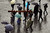 People carry a cross through St Peter's Square as they wait for news on the election of a new Pope on March 13, 2013 in Vatican City, Vatican. (Photo by Joe Raedle/Getty Images)