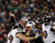 New England Patriots quarterback Tom Brady (12) passes under pressure from the Baltimore Ravens in the NFL AFC Championship football game in Foxborough, Massachusetts, January 20, 2013. REUTERS/Adam Hunger
