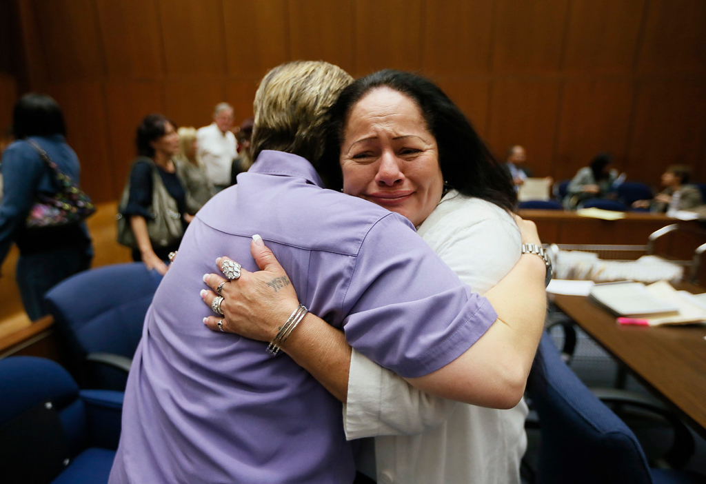 Description of . Victoria Rios, 49, (R) hugs Prototypes residential treatment Program Director April Wilson, at the Second Chance Women's Re-entry Court in Los Angeles, April 19, 2013. The court program is one of the first in the U.S. to focus on women, and offers a cost-saving alternative to prison for women who plead guilty to non-violent crimes and volunteer for treatment. Of the 297 women who have been through the court since 2007, 100 have graduated, and only 35 have been returned to state prison. Picture taken April 19, 2013.  REUTERS/Lucy Nicholson