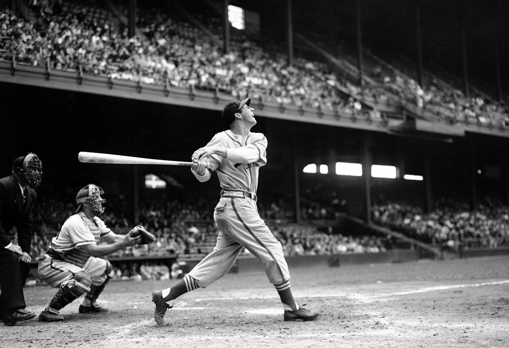 Description of . FILE - In this May 22, 1946 file photo, St. Louis Cardinals' Stan Musial bats against the Philadelphia Phillies during a baseball game at Shibe Park in Philadelphia, Pa. Musial, one of baseball's greatest hitters and a Hall of Famer with the Cardinals for more than two decades, died Saturday, Jan 19, 2013, the team announced. He was 92. (AP Photo/Warren M. Winterbottom, File)