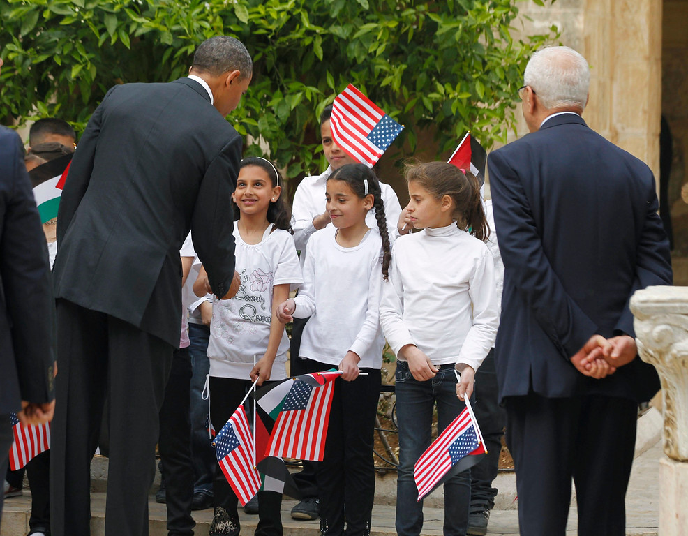 Description of . U.S. President Barack Obama interacts with children as he tours the Church of the Nativity in Bethlehem March 22, 2013.   REUTERS/Jason Reed