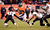 Denver Broncos running back Ronnie Hillman (21) runs the ball against Baltimore Ravens defensive back Chykie Brown (23) during the third quarter.  The Denver Broncos vs Baltimore Ravens AFC Divisional playoff game at Sports Authority Field Saturday January 12, 2013. (Photo by John Leyba,/The Denver Post)