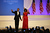U.S. President Barack Obama and first lady Michelle Obama greet the crowd at the Commander-In-Chief's Inaugural Ball January 21, 2013 in Washington, DC. Obama was sworn in today for his second term in a public ceremonial swearing in.  (Photo by Joe Raedle/Getty Images)