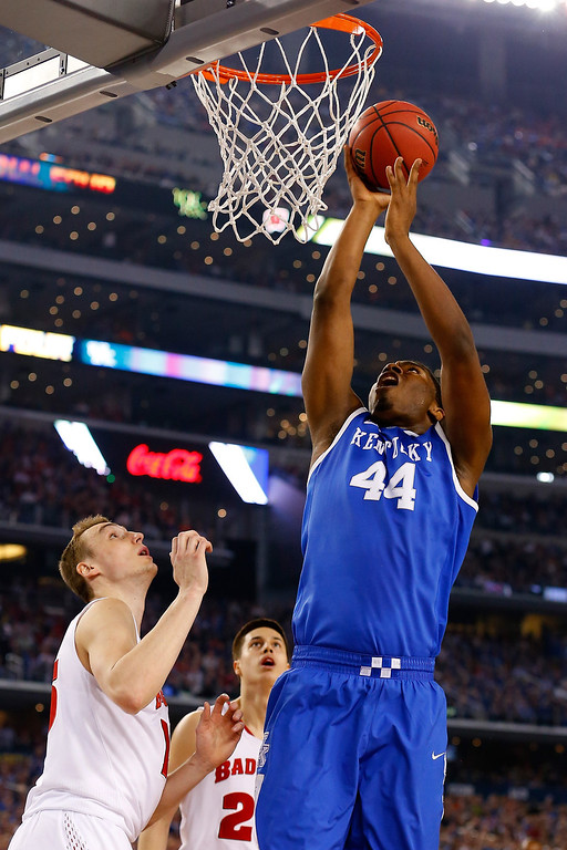 Description of . ARLINGTON, TX - APRIL 05: Dakari Johnson #44 of the Kentucky Wildcats goes up for a basket against the Wisconsin Badgers during the NCAA Men's Final Four Semifinal at AT&T Stadium on April 5, 2014 in Arlington, Texas.  (Photo by Tom Pennington/Getty Images)