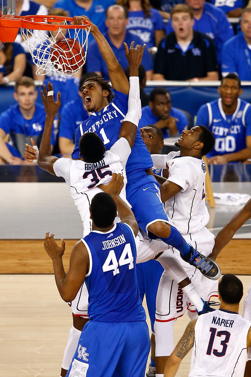 Description of . ARLINGTON, TX - APRIL 07: James Young #1 of the Kentucky Wildcats dunks over Amida Brimah #35 of the Connecticut Huskies during the NCAA Men\'s Final Four Championship at AT&T Stadium on April 7, 2014 in Arlington, Texas.  (Photo by Tom Pennington/Getty Images)