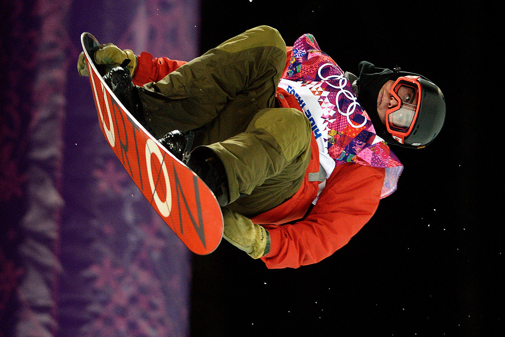 Description of . Switzerland's Christian Haller rides during the men's snowboard halfpipe final. Sochi 2014 Winter Olympics on Tuesday, February 11, 2014. (Photo by AAron Ontiveroz/The Denver Post)