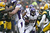 Adrian Peterson #28 of the Minnesota Vikings runs the ball against the Green Bay Packers at Lambeau Field on December 2, 2012 in Green Bay, Wisconsin.  The Packers defeated the Vikings 23-14.  (Photo by Wesley Hitt/Getty Images)