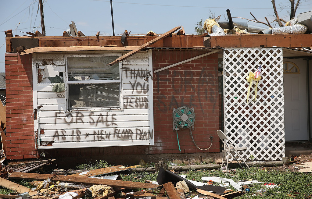 Description of . MOORE, OK - MAY 23: A homeowner displays a humorous message after his home was destroyed by a tornado, on May 23, 2013 in Moore, Oklahoma. A two-mile wide EF5 tornado touched down in Moore May 20 killing at least 24 people and leaving behind extensive damage to homes and businesses. U.S. President Barack Obama promised federal aid to supplement state and local recovery efforts.  (Photo by Scott Olson/Getty Images)