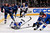 Vladimir Tarasenko #91 of the St. Louis Blues dives to move the puck over the blue line against Tyson Barrie #41 of the Colorado Avalanche at the Pepsi Center on February 20, 2013 in Denver, Colorado.  (Photo by Doug Pensinger/Getty Images)