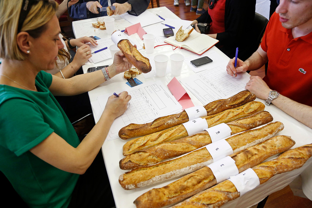 Description of . Jury members taste and select baguettes, French bread, which compete for the 'Grand Prix de la Baguette de la Ville de Paris' (Best Baguette of Paris 2013) annual prize at the Chambre Professionnelle des Artisans Boulangers Patissiers in Paris April 25, 2013. The baguette is a French cultural symbol par excellence and the competition saw 203 Parisian bakers who compete for recognition as finest purveyor of one of France's most iconic staples. The baguettes are registered, given anonymous white wrappings and an identification number. They are then carefully weighed and measured to ensure they do not violate the contest's strict rules. 52 entries were withdrawn for failing to measure between 55-70cm long or not matching the acceptable weight of between 250-300g. Every year, the winner earns the privilege of baking bread for the French President.   REUTERS/Charles Platiau