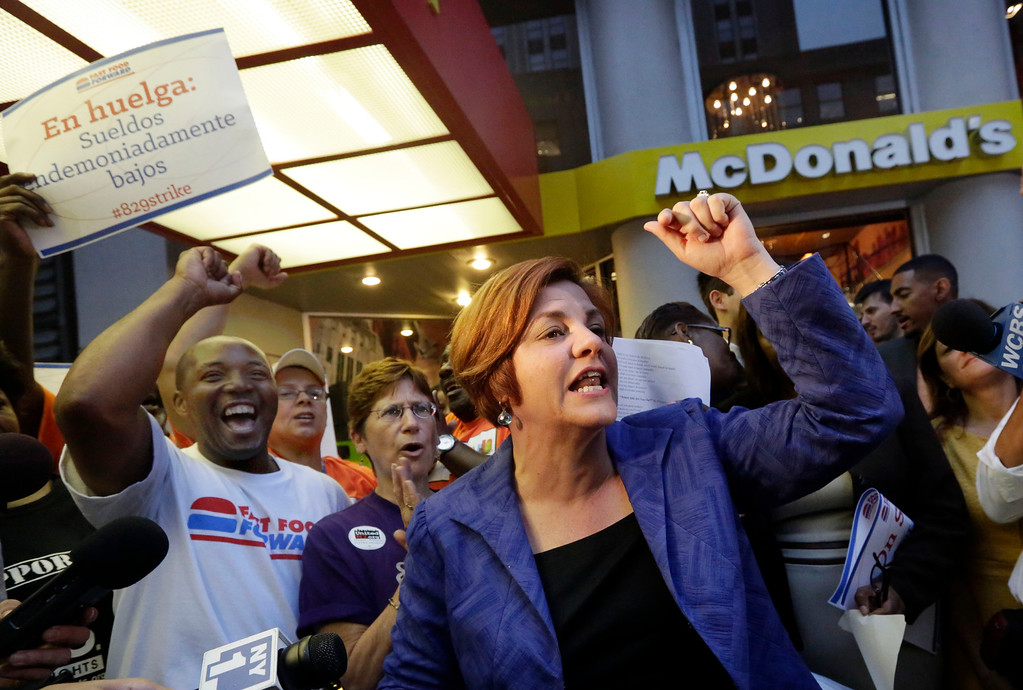 Description of . New York City Council Speaker and mayoral candidate Christine Quinn speaks at a fast food workers' protest outside a McDonald's restaurant on New York's Fifth Avenue, Thursday, Aug. 29, 2013.  (AP Photo/Richard Drew)