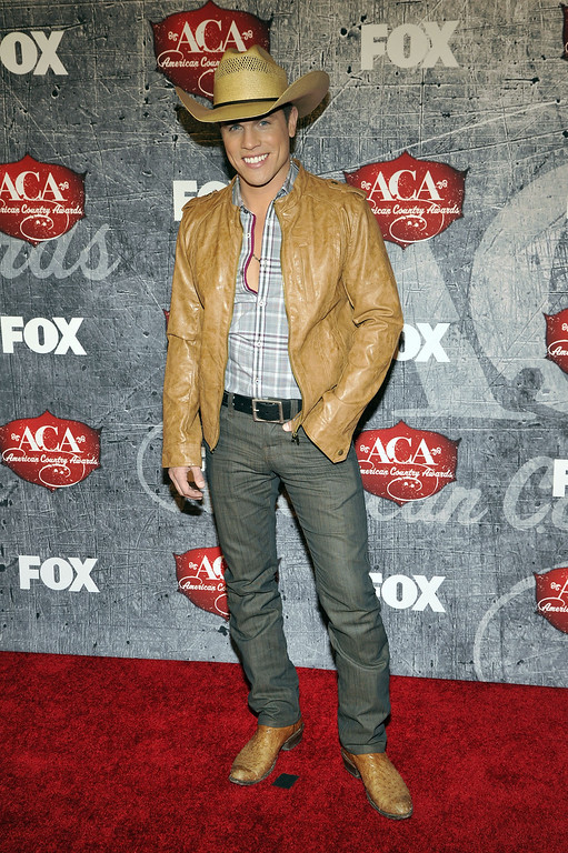 Description of . Singer Dustin Lynch arrives at the American Country Awards on Monday, Dec. 10, 2012, in Las Vegas. (Photo by Jeff Bottari/Invision/AP)