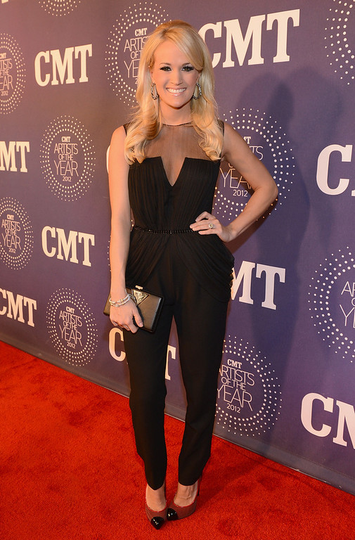 Description of . Carrie Underwood attends 2012 CMT Artists Of The Year at The Factory at Franklin on December 3, 2012 in Franklin, Tennessee.  (Photo by Rick Diamond/Getty Images for CMT)