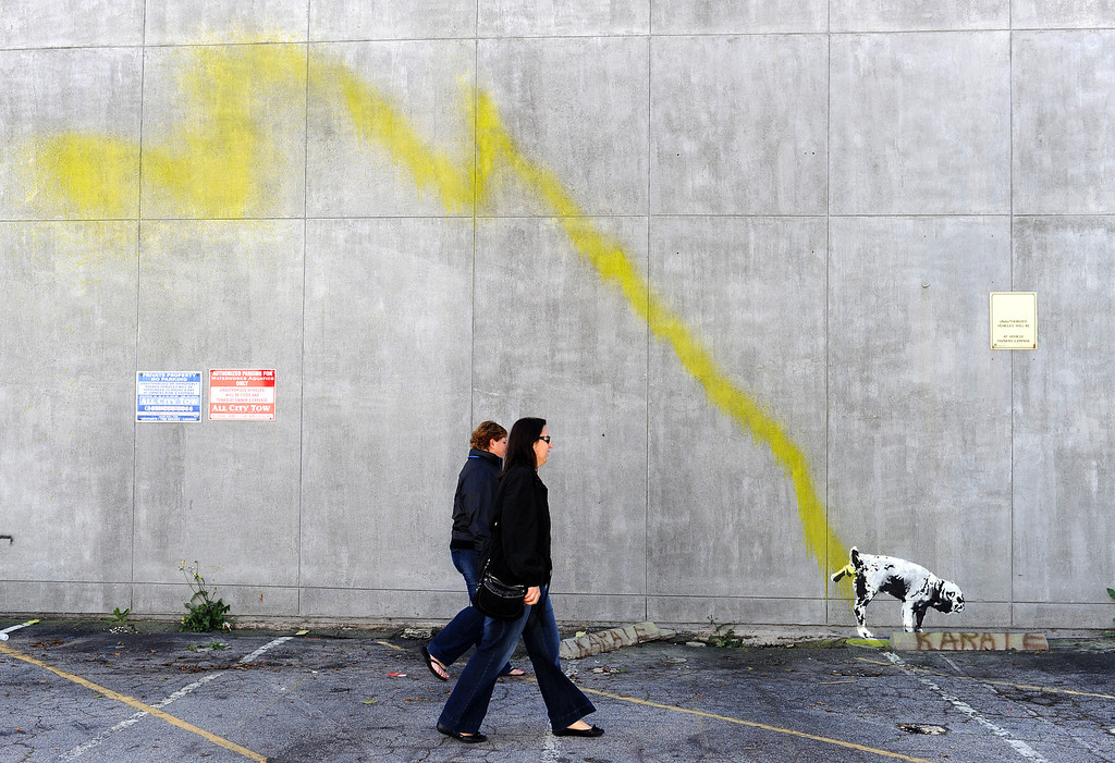 Description of . A graffiti attributed to secretive British artist Banksy shows a dog urinating on a wall in Beverly Hills, California on February 17, 2011. Another graffiti was ripped down Wednesday in Hollywood, amid sightings of other pieces in a reported pre-Oscars publicity stunts. Banksy is nominated for best documentary for