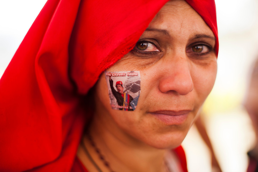 Description of . A supporter of late Venezuela's President Hugo Chavez await their turn to pay their last homage to their leader, in Caracas, on March 12, 2013. The campaign to succeed the late Hugo Chavez in Venezuela has officially begun. LEO RAMIREZ/AFP/Getty Images