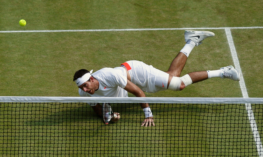 Description of . Juan Martin Del Potro of Argentina eyes the ball as he plays a return to Novak Djokovic of Serbia during their Men\'s singles semifinal match at the All England Lawn Tennis Championships in Wimbledon, London, Friday, July 5, 2013. (AP Photo/Jonathan Brady, Pool)