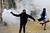 An Egyptian protester runs to throw tear gas during a protest in Tahrir Square on January 25, 2013 in Cairo. Huge crowds are expected to demonstrate in Egypt on the second anniversary of the revolution that ousted Hosni Mubarak and brought in an Islamist government, as political tensions simmer and economic woes bite. MOHAMMED ABED/AFP/Getty Images