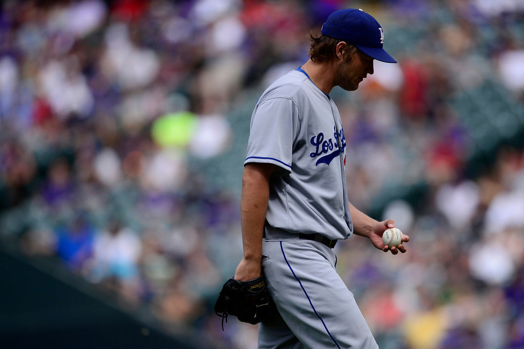 Description of . Clayton Kershaw (22) of the Los Angeles Dodgers struggles against the Colorado Rockies en route to giving up the most hits of a game this season during the action in Denver on Monday, September 2, 2013. The Colorado Rockies hosted the Los Angeles Dodgers at Coors Field.   (Photo by AAron Ontiveroz/The Denver Post)