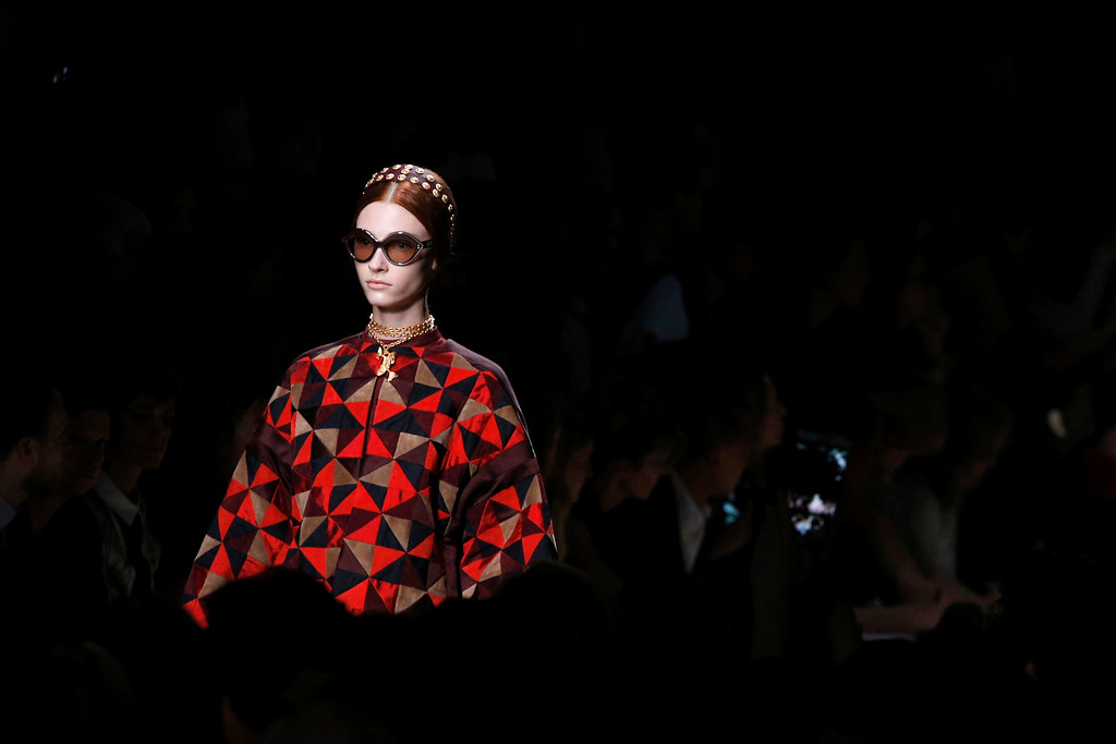 Description of . A model presents a creation as part of Valentino's ready-to-wear Spring/Summer 2014 fashion collection, presented Tuesday, Oct. 1, 2013 in Paris. (AP Photo/Christophe Ena)