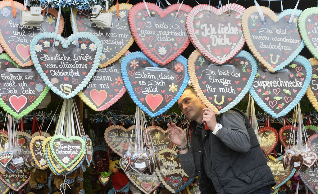 Description of . A vendor displays his selection of heart-shaped gingerbread prior to the opening of the Bavarian Oktoberfest beer festival at the Theresienwiese in Munich, southern Germany, on September 21, 2013. The world's biggest beer festival Oktoberfest will run until October 6, 2013.  AFP PHOTO / CHRISTOF  STACHE/AFP/Getty Images