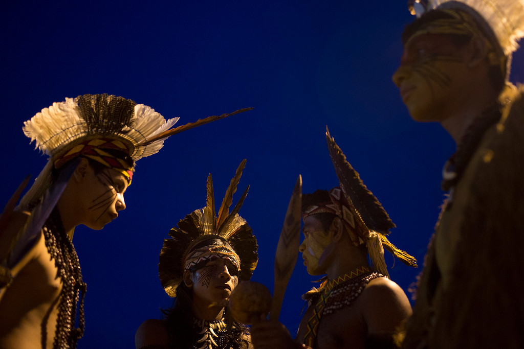 Description of . Pataxo Indians gather during the indigenous games in Cuiaba, Brazil, Tuesday, Nov. 12, 2013. (AP Photo/Felipe Dana)