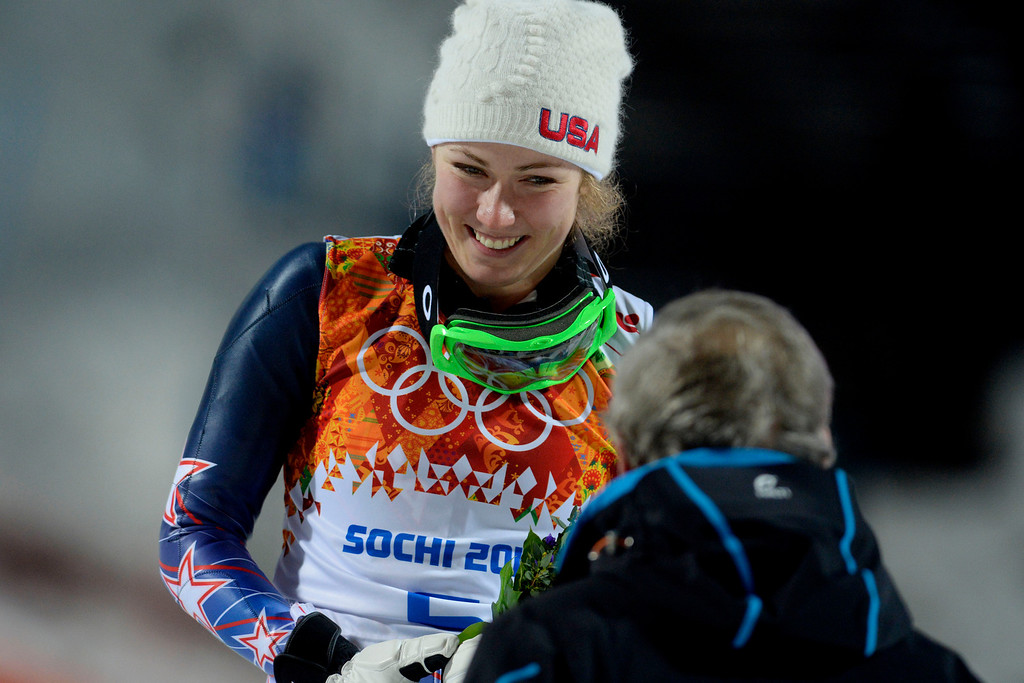 Description of . Gold medalist American Mikaela Shiffrin smiles at U.S. Ski President Bill Marolt winning ladies' slalom run 2. Sochi 2014 Winter Olympics on Friday, February 21, 2014 at Rosa Khutor Alpine Center. (Photo by AAron Ontiveroz/ The Denver Post)