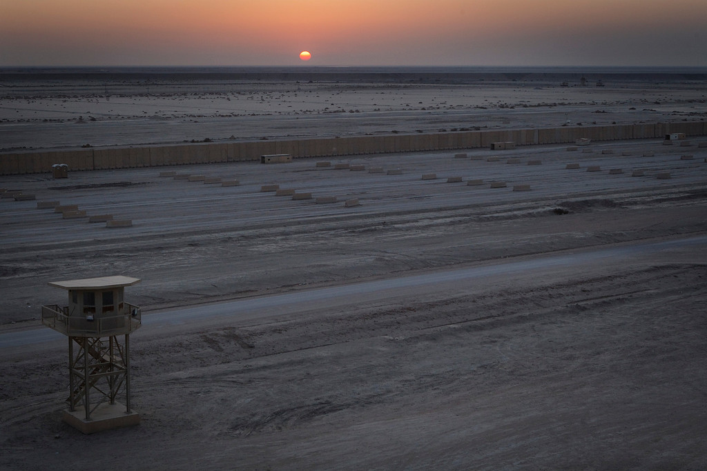 . The sun sets behind an empty staging area in Camp Adder which is the departure point for the last U.S. military convoy to leave the country on December 17, 2011 near Nasiriyah, Iraq. All U.S. troops were scheduled to have departed Iraq by December 31, 2011. (Photo by Lucas Jackson-Pool/Getty Images)