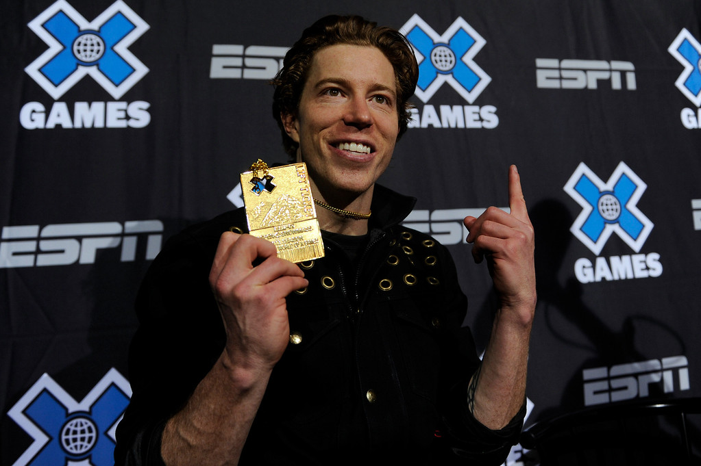 Description of . ASPEN, CO - JANUARY 27: Shaun White shows his medal during a press conference after winning the men's superpipe event at Winter X Games Aspen 2013 at Buttermilk Mountain on Jan. 27, 2013, in Aspen, Colorado. White scored 98 points. (Photo by Daniel Petty/The Denver Post)