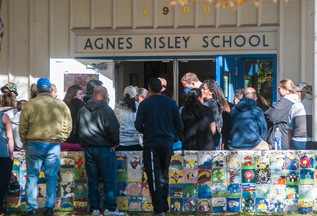 Description of . Parents wait for officials to release their children from Agnes Risley Elementary School, where some students were evacuated to after a shooting at Sparks Middle School on Monday, Oct. 21, 2013 in Sparks, Nev. (AP Photo/Kevin Clifford)