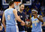 Denver Nuggets guard Ty Lawson (3) is greeted by teammate Danilo Gallinari (8) as he walks off the court during a time out in the fourth quarter of an NBA basketball game against the Oklahoma City Thunder in Oklahoma City, Tuesday, March 19, 2013. Denver won 114-104. (AP Photo/Sue Ogrocki)