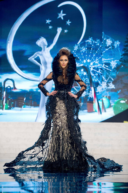 Description of . Miss Malaysia Kimberley Leggett performs onstage at the 2012 Miss Universe National Costume Show at PH Live in Las Vegas, Nevada December 14, 2012. The 89 Miss Universe Contestants will compete for the Diamond Nexus Crown on December 19, 2012. REUTERS/Darren Decker/Miss Universe Organization/Handout