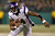 Quarterback Joe Webb #14 of the Minnesota Vikings runs the ball against the Green Bay Packers in the first quarter during the NFC Wild Card Playoff game at Lambeau Field on January 5, 2013 in Green Bay, Wisconsin.  (Photo by Jonathan Daniel/Getty Images)