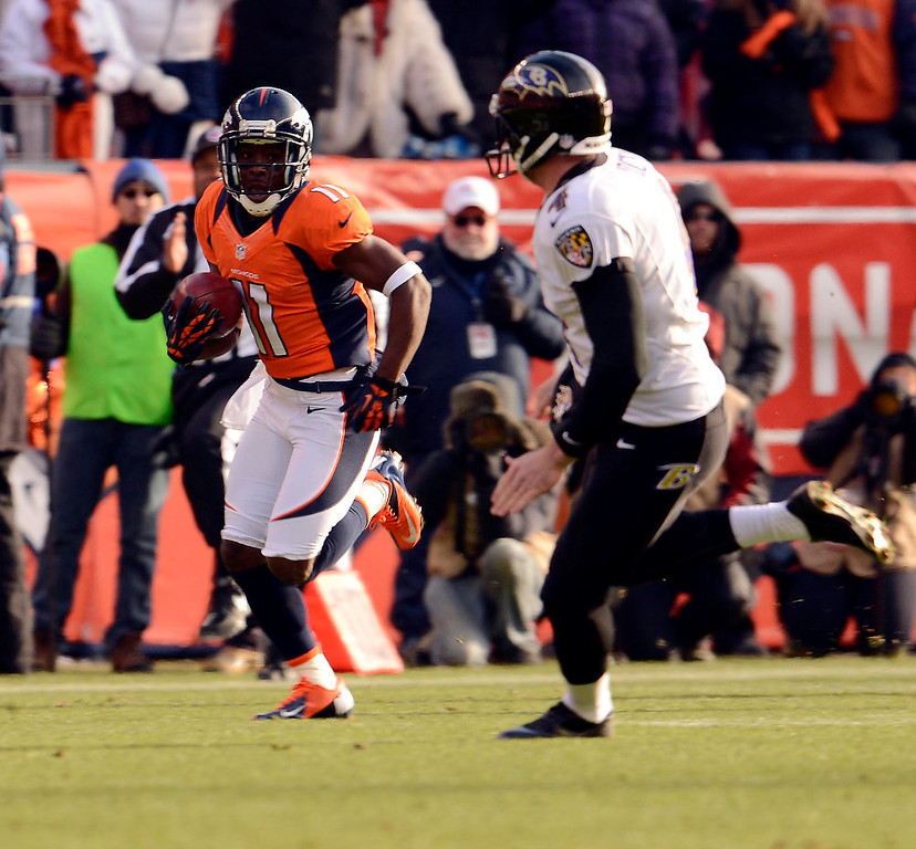 Description of . Denver Broncos wide receiver Trindon Holliday (11) scores a touchdown on an 89 yard punt return early in the first quarter.  The Denver Broncos vs Baltimore Ravens AFC Divisional playoff game at Sports Authority Field Saturday January 12, 2013. (Photo by John Leyba,/The Denver Post)