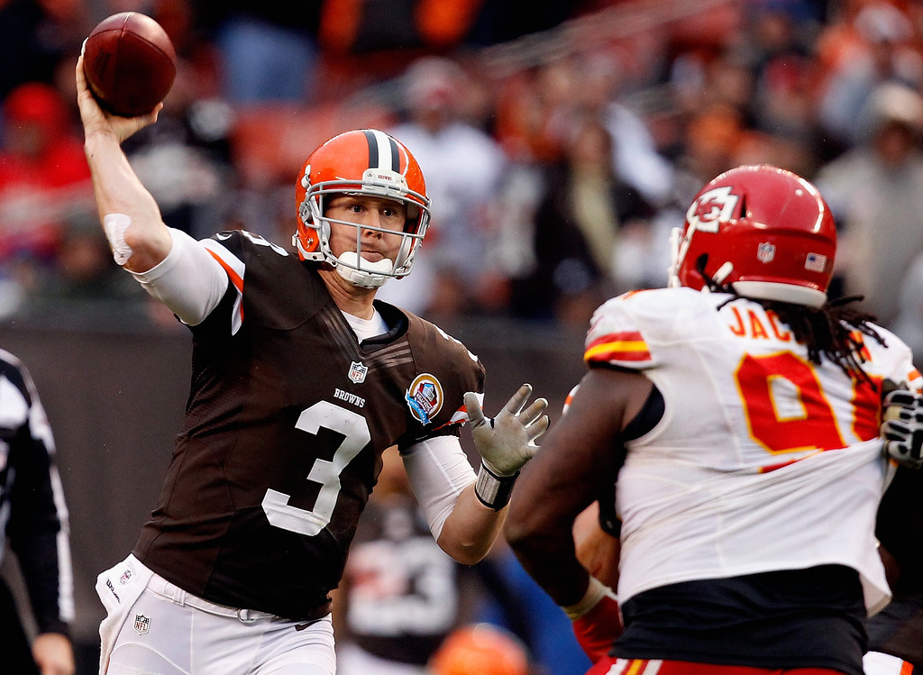 Description of . CLEVELAND, OH - DECEMBER 09:  Quarterback Brandon Weeden #3 of the Cleveland Browns throws to a receiver over defensive end Tyson Jackson #94 of the Kansas City Chiefs at Cleveland Browns Stadium on December 9, 2012 in Cleveland, Ohio.  (Photo by Matt Sullivan/Getty Images)