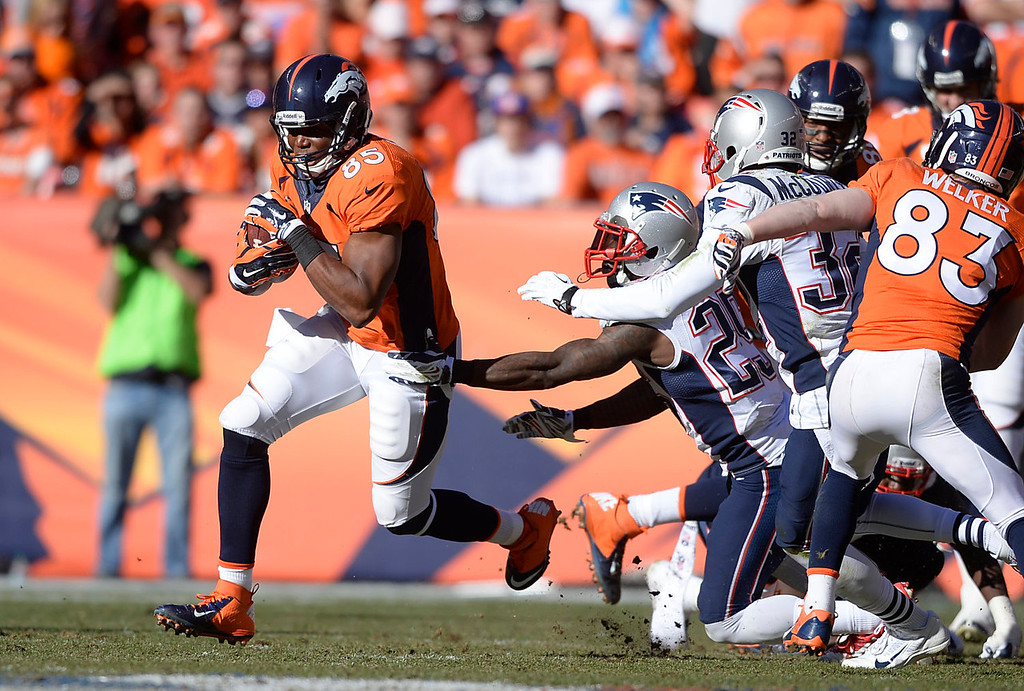Description of . Denver Broncos tight end Virgil Green (85) makes a run in the second quarter. The Denver Broncos take on the New England Patriots in the AFC Championship game at Sports Authority Field at Mile High in Denver on January 19, 2014. (Photo by AAron Ontiveroz/The Denver Post)