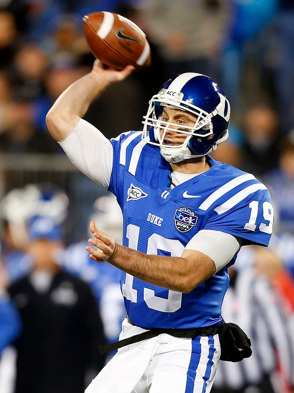 Description of . Duke's Sean Renfree (19) throws a pass against Cincinnati during the first half of the NCAA college football Belk Bowl in Charlotte, N.C., Thursday, Dec. 27, 2012. (AP Photo/Chuck Burton)
