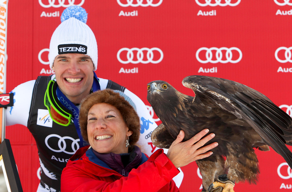 Description of . Christof Innerhofer from Italy, stands at the podium with a golden eagle after winning at the men's World Cup downhill ski race in Beaver Creek, Colo., on Friday, Nov. 30, 2012. (AP Photo/Alessandro Trovati)