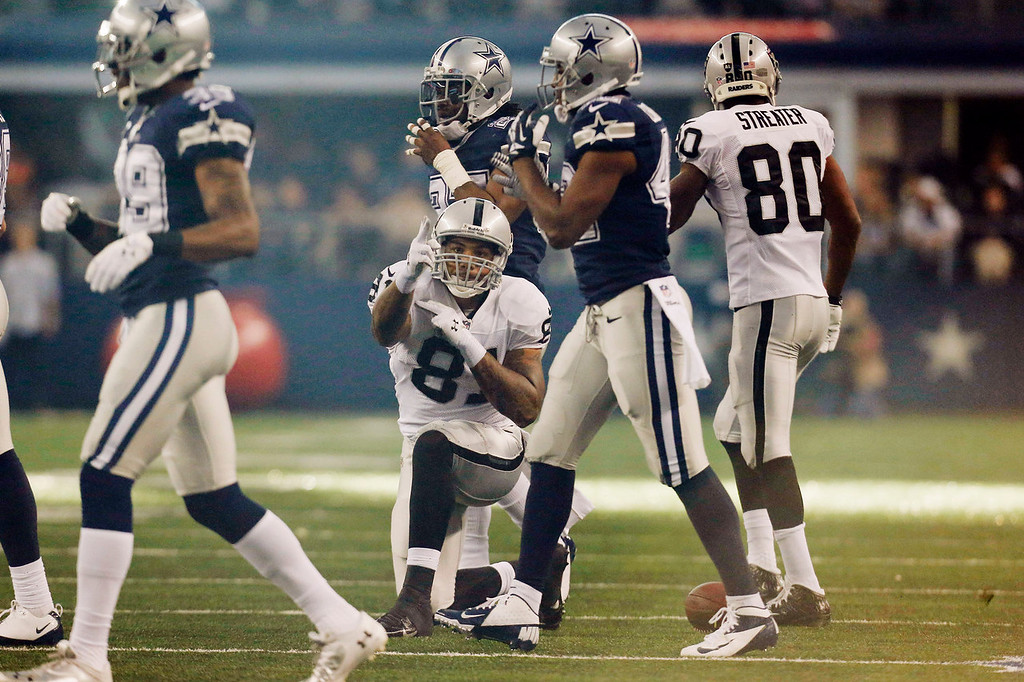 Description of . Oakland Raiders tight end Mychal Rivera (81) celebrates after a run against the Dallas Cowboys during the first half of an NFL football game, Thursday, Nov. 28, 2013, in Arlington, Texas.  (AP Photo/Brandon Wade)