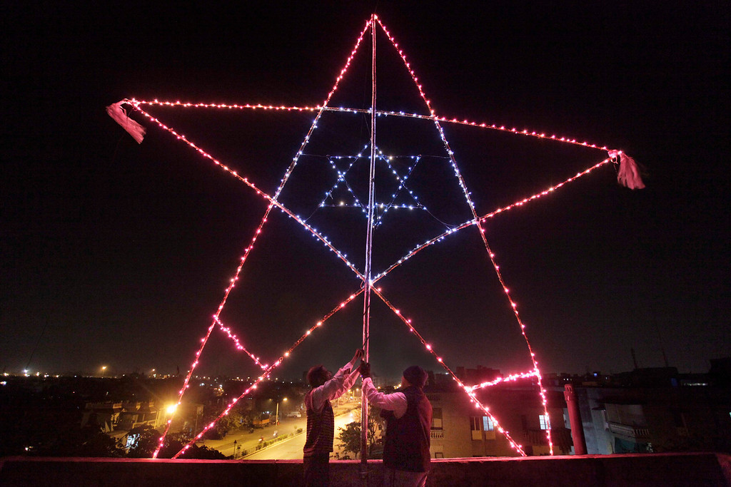 Description of . Indian Christians illuminate a 23-foot huge star on the terrace of their residential building in Ahmadabad, India.  Although Christians comprise only two percent of the Indian population but Christmas is a national holiday and is observed across the country as an occasion to celebrate. (AP Photo/Ajit Solanki)