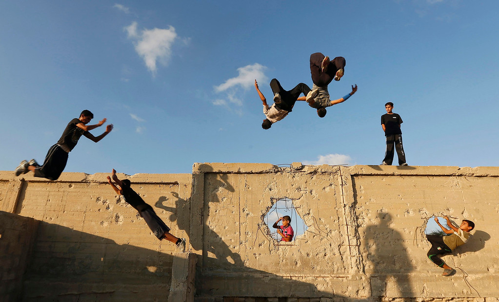 Description of . Palestinian youths practice their parkour skills in Khan Younis in the southern Gaza Strip September 12, 2012. Some youths, aged between 12 and 23 years old, in Gaza are training in parkour which was developed in France. Parkour is a physical discipline of movement focused on overcoming obstacles. Training is held in cemeteries, and in former Israeli settlements. REUTERS/Mohammed Salem