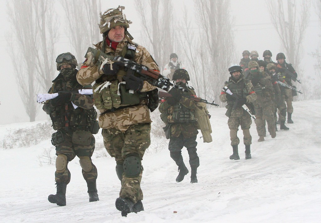 Description of . Ukrainian servicemen of the Donbass volunteer battalion take part in clean-up operations in a village in the Lysychansk district of the Lugansk region, controlled by pro-Russian separatists on January 28, 2015.  Ukraine's president appealed to Russia's Vladimir Putin and Washington threatened tougher measures should Moscow fail to rein in separatist fighters mounting a new offensive in the east of the ex-Soviet republic. ANATOLII BOIKO/AFP/Getty Images
