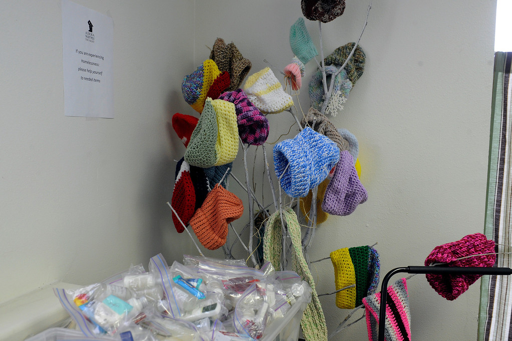 Description of . AURORA, CO - NOVEMBER 21: A supply of hand-knit hats wait to be distributed to homeless clients at the Aurora Warms the Night facility on November 21, 2013, in Aurora, Colorado. (Photo by Anya Semenoff/YourHub)
