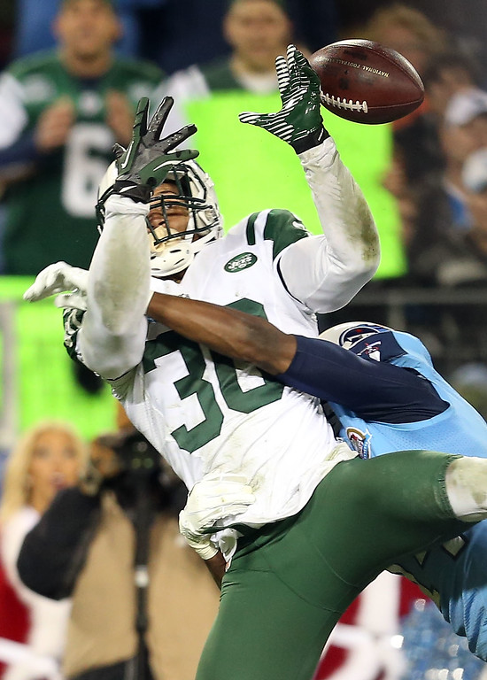 Description of . NASHVILLE, TN - DECEMBER 17:  Free safety LaRon Landry #30 of the New York Jets attempts to intercept the ball against the Tennessee Titans at LP Field on December 17, 2012 in Nashville, Tennessee.  (Photo by Andy Lyons/Getty Images)