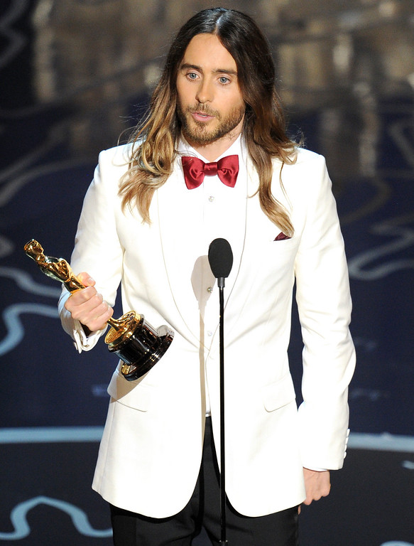 Description of . Actor Jared Leto accepts the Best Performance by an Actor in a Supporting Role award for 'Dallas Buyers Club' onstage during the Oscars at the Dolby Theatre on March 2, 2014 in Hollywood, California.  (Photo by Kevin Winter/Getty Images)