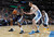 Memphis Grizzlies forward Zach Randolph, left, pulls in a loose ball as Denver Nuggets forward Kosta Koufos covers in the first quarter of an NBA basketball game in Denver, Friday, March 15, 2013. (AP Photo/David Zalubowski)