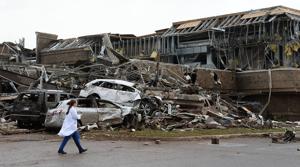 . A nurse walks the destruction at Moore hospital after a huge tornado struck Moore, Oklahoma, near Oklahoma City, May 20, 2013.  A huge tornado with winds of up to 200 miles per hour (320 kph) devastated the Oklahoma City suburb of Moore on Monday, ripping up at least two elementary schools and a hospital and leaving a wake of tangled wreckage.  REUTERS/Gene Blevins