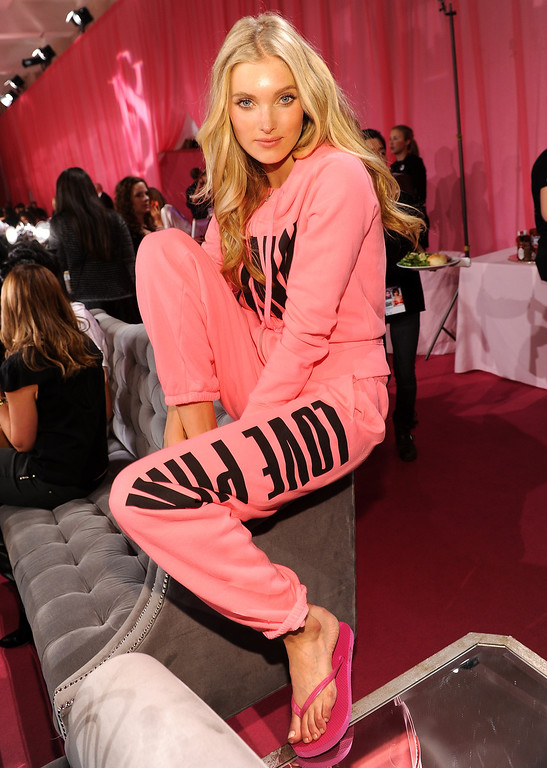Description of . Model Elsa Hosk prepares at the 2013 Victoria's Secret Fashion Show hair and make-up room at Lexington Avenue Armory on November 13, 2013 in New York City.  (Photo by Dimitrios Kambouris/Getty Images for Victoria's Secret)